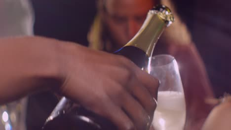 CU-Pouring-Champagne-into-Glass-in-Slow-Motion