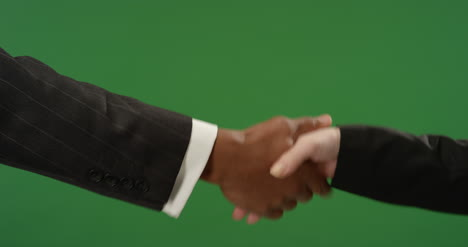 CU-Two-people-in-suits-shaking-hands-on-green-screen