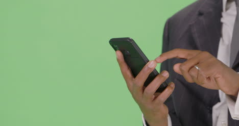 CU-Businessman-takes-out-phone-and-texts-on-green-screen