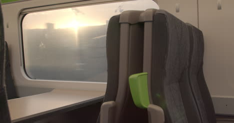 Looking-out-train-window-with-morning-sun