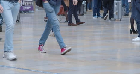 CU-Feet-walking-in-busy-train-station-in-slow-motion