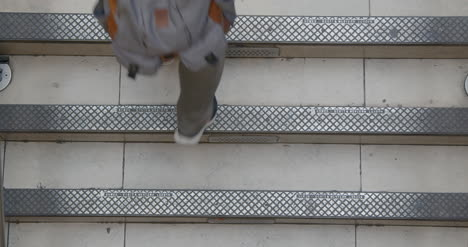 People-walking-up-and-down-stairs-from-overhead