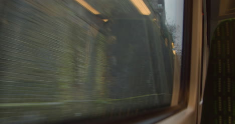 Looking-out-from-moving-train-exiting-tunnel