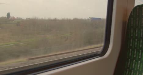 Looking-out-train-window-passing-road