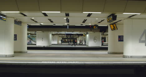 Commuters-waiting-on-train-platforms