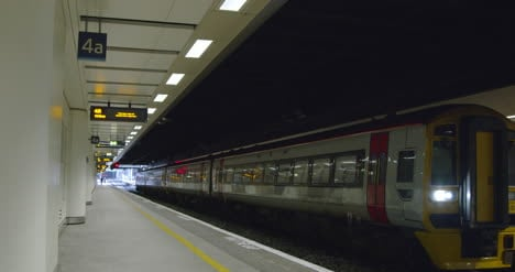 Train-arriving-at-station-with-passenger-waiting