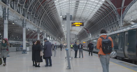 Passengers-walk-along-platform-at-London-Paddington-Station