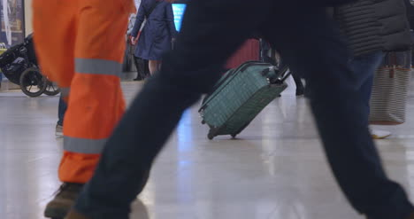 People-walking-in-busy-train-station-in-slow-motion-