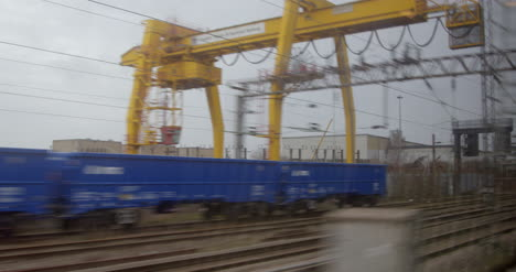 Looking-out-from-train-passing-gantry-crane