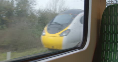 Looking-out-from-moving-train-passing-another-train