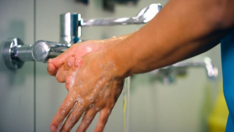 Female-Medical-Worker-Washes-Hands