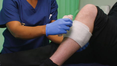 CU-Nurse-Bandaging-Injured-Leg