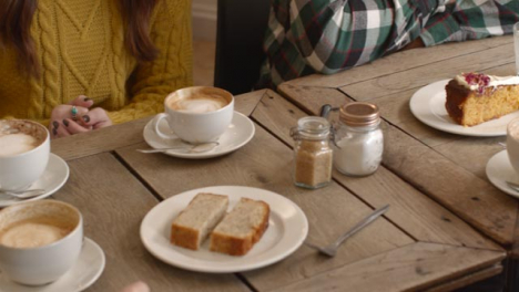 Cafe-Table-with-Coffee-and-Cakes