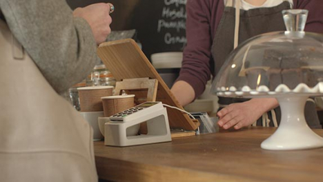 Woman-Paying-for-Coffee-Using-Contactless