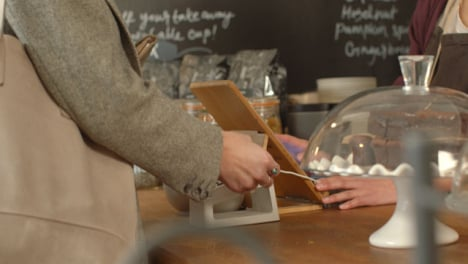 Woman-Using-Contactless-Payment-in-Cafe