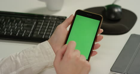 CU-Woman-Tapping-on-Phone-With-Green-Screen