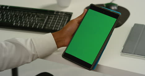 CU-Man-at-Tapping-on-Tablet-with-Green-Screen