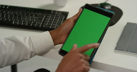 CU-Man-at-Swiping-on-Tablet-with-Green-Screen