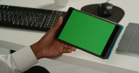 CU-Man-at-Swipes-on-Tablet-with-Green-Screen