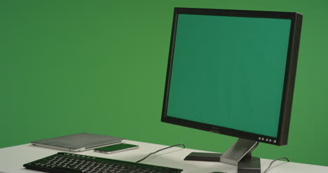 Desk-with-Computer-Monitor-on-Green-Screen
