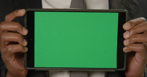 CU-Man-Holds-Tablet-at-Camera-with-Green-Screen