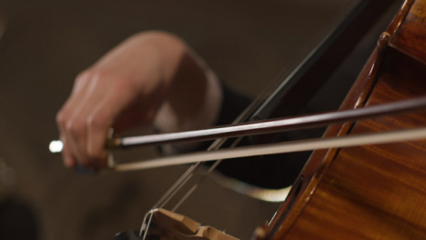 Extreme-Close-Up-Of-Bow-On-Cello-Strings