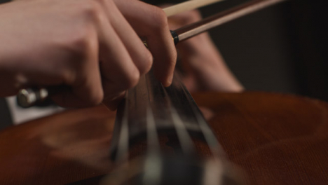 Hands-Of-Male-Cellist-Plucking-Strings-On-Cello