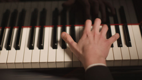 Hands-Of-Male-Pianist-Playing-Piano
