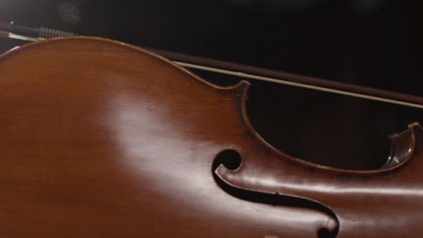 Panning-Shot-of-Cello-With-Bow