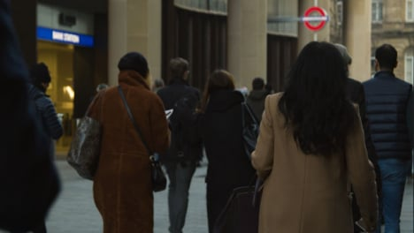 Rear-View-Of-Pedestrians-Walking-In-Busy-London-Street-Daytime