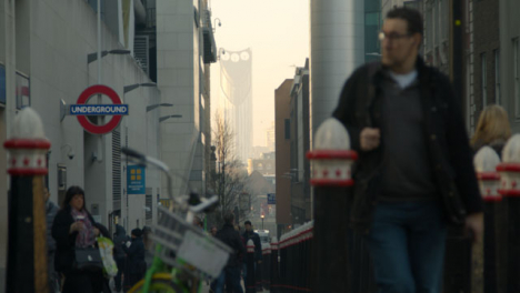 Pedestrians-Walking-In-A-Busy-London-Street-Near-Tube-Station-Daytime