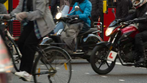 Cyclists-And-Traffic-On-A-Busy-London-Street-Daytime