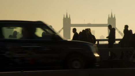 Pedestrians-And-Traffic-Crossing-Busy-London-Bridge