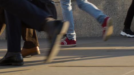 Close-Up-Of-Feet-Walking-On-Pavement