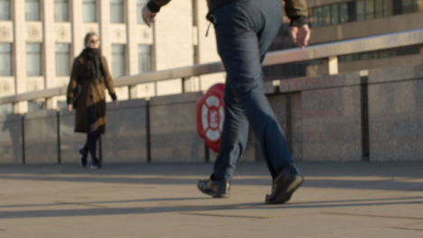 Close-Up-Of-Feet-Walking-On-Quiet-Pavement