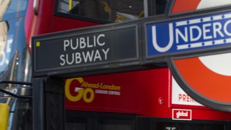 London-Bus-Passing-London-Underground-Sign