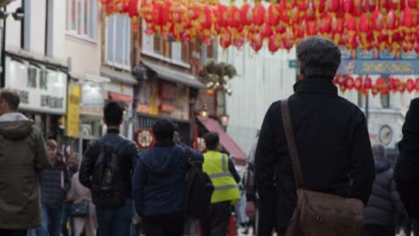 Pedestrians-Walking-In-Chinatown-Central-London-Street-blurred