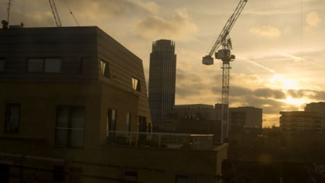 Crane-in-London-Skyline-From-A-Moving-Train