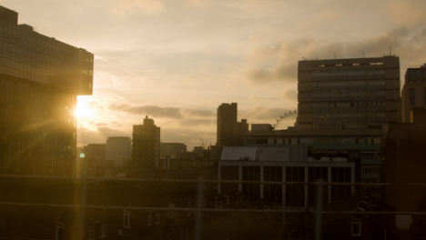 London-Skyline-at-Sundown-From-Moving-Train