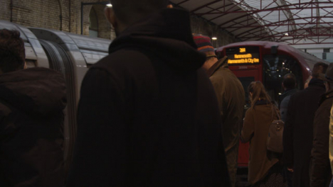 Commuters-Waiting-on-Platform-at-London-Underground-Station