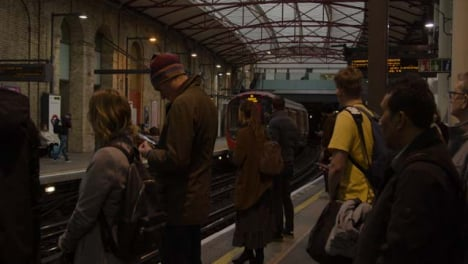 Commuters-Waiting-For-Train-On-Platform-Of-London-Station