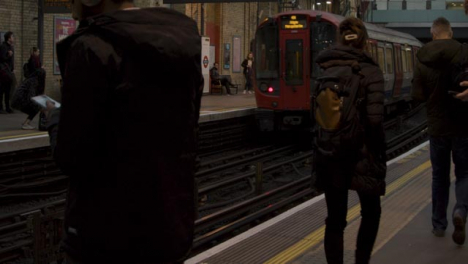 Commuters-Waiting-For-Train-On-London-Train-Station-Platform-