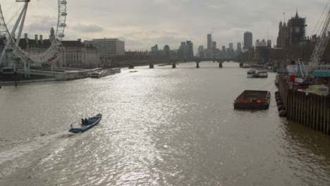 Boat-on-the-The-River-Thames-With-London-Cityscape