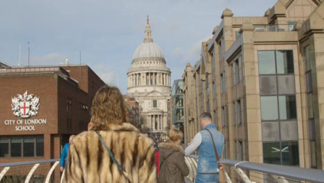 St-Pauls-Cathedral-And-Pedestrians-On-Millennium-Bridge-London