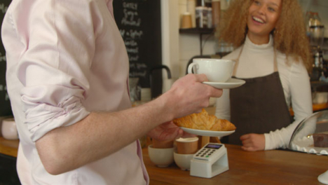 Man-Carries-Away-Croissant-and-Coffee-01