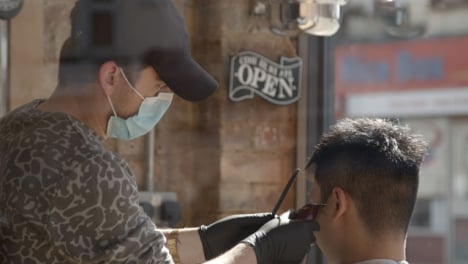 Pull-Focus-Barber-Wearing-Face-Mask-to-Open-Sign
