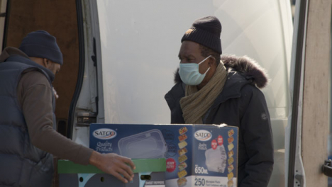 Man-Helps-Unload-Van-Wearing-Face-Mask