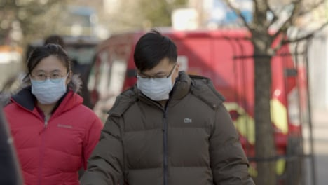 Male-and-Female-walking-on-street-wearing-face-masks