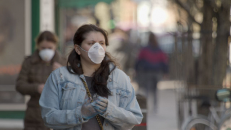 Women-walking-on-street-while-wearing-face-masks