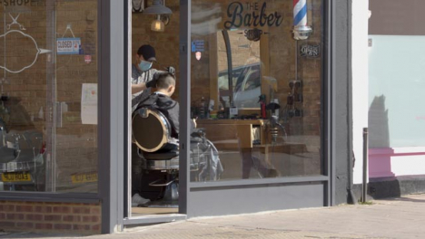 Barber-Wearing-Face-Mask-in-Barber-Shop-Cuts-Hair-